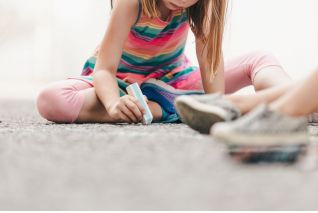 little-girl-drawing-with-chalk-on-ground